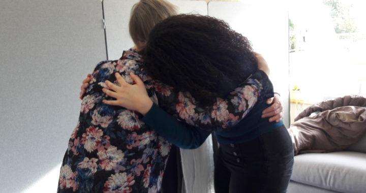 three women hugging