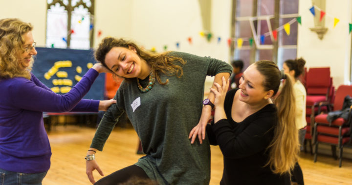 three happy women performing and having fun